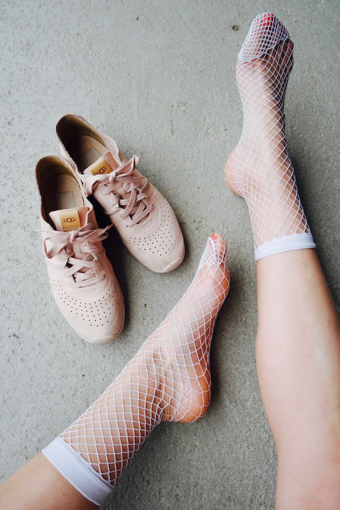 Fishnets + UGG sneakers
